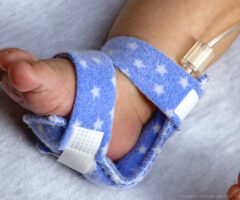 Dale PediPrint Bendable Armboard on an infant's foot